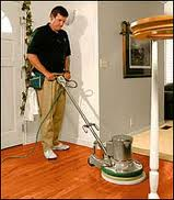 professional cleaner buffing hardwood floor